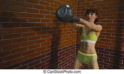 Exercise with weight. Girl doing exercise with weight