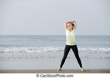 Exercise woman smiling at the beach