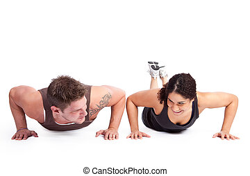 Exercise woman with trainer - A woman doing pushups with her...