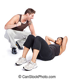 Exercise woman with trainer