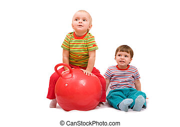 Exercises - Boy and girl doing exercises with big red ball. ...