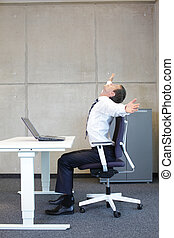 exercises in office. business man taking short break for...
