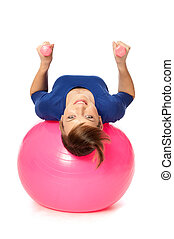 Exercises with dumbbells on a gymnastic ball