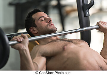 Exercising Chest With Barbell