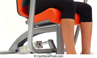 Exercising on modern hydraulic trainer close-up