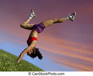 Exercising outdoors - Girl exercising outdoors against...