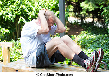 Exercising - Closeup portrait, healthy elderly man doing...