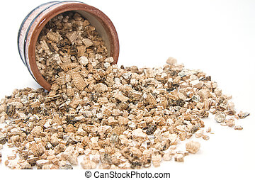 Exfoliated perlite and Vermiculite on white background -...
