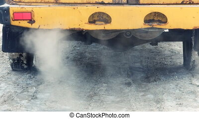 Exhaust gases from the muffler running car. - Exhaust gases...