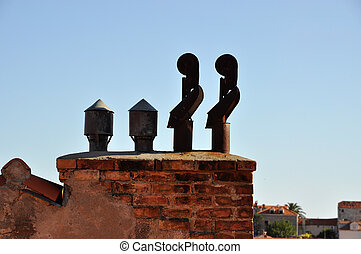 Exhaust pipes - Four exhaust pipes on a brick chimney
