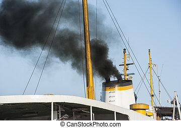 Exhaust smoke from a ship smoke stack