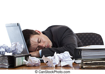 Exhausted and tired businessman sleeping in office at laptop...