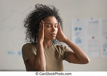 Exhausted black woman worker massage temples having headache