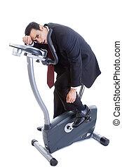 Exhausted Businessman on Exercise Bike Isolated White Background