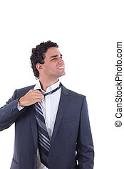 exhausted businessman removing tie