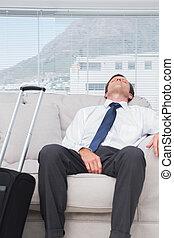 Exhausted businessman sleeping