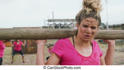 Exhausted Caucasian woman exercising at bootcamp - Front ...