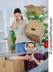 exhausted couple taking a break from packing