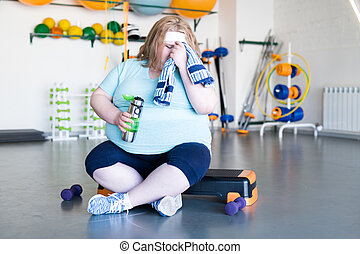 Exhausted fat Woman after Workout