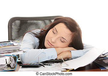 Exhausted female filling out tax forms