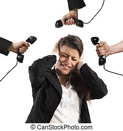 Businesswoman stressed and annoyed by business calls