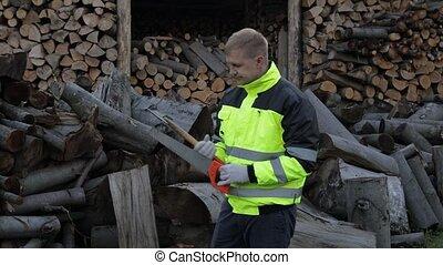 Exhausted from work lumberjack. Man woodcutter. Sawn logs, ...
