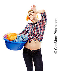Exhausted housewife with the laundry basket - Studio shot of...