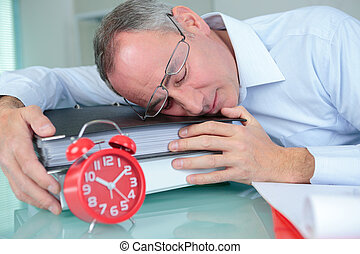 exhausted man sleeping on the desk