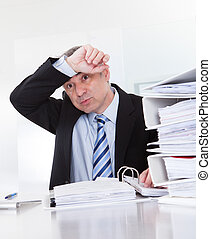 Exhausted Mature Businessman At Work