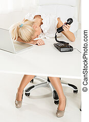 Exhausted Secretary - A young pretty businesswoman,...