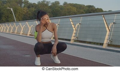 Exhausted woman after jogging catching her breath - ...