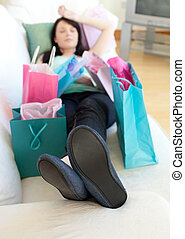 Exhausted woman relaxing after shopping - Exhausted woman...