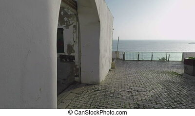 Exit from the ancient streets of Albufeira to sea. - Exit...