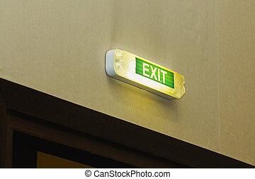 Exit - inscription over the door - green emergency lighting sign