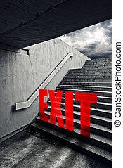 EXIT on Urban staircase in underground passage