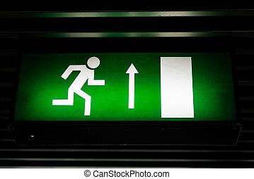 Exit sign in dark colors