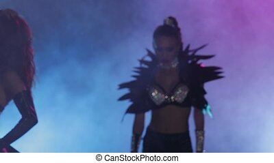 Exit to smoky scene girl dancer in erotic leather costume