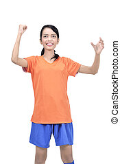 Exited asian footbal player woman with winner expression