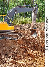 exkavator digging clay