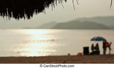 Exotic beach with sun loungers silhouettes Vietnam. The city of Nha Trang.