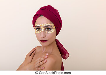 Exotic beauty - Beautiful model with gold leaf make-up and...