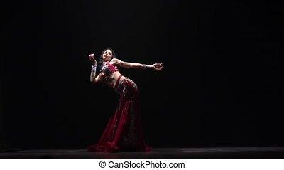 Exotic belly dancer woman in chiffon dress. Black...