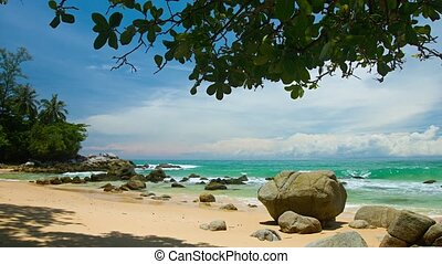 Exotic, Boulder Strewn, Tropical Beach with Clouds over the...
