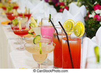 exotic cocktails and flowers on table