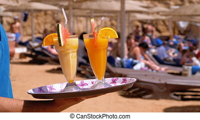 Exotic Cocktails in a Glass with a Straw on a Tray on the Background of the Sea. Egypt.
