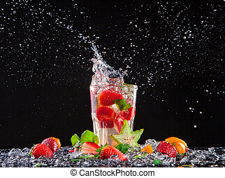 Exotic drink with splash on black background - Exotic drink...