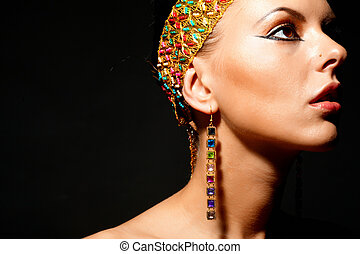Exotic female - Gorgeous woman with exotic accessories on...