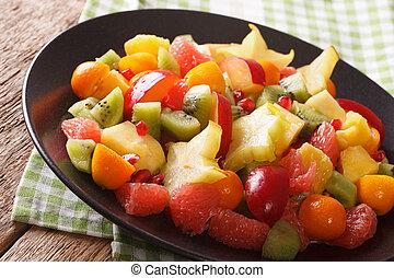 Exotic Food: salad of orange, kumquat, pineapple, carambola,...