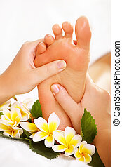 Exotic foot massage and spa foot treatment.