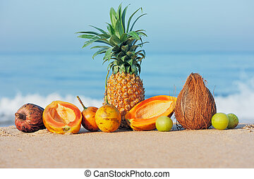 Exotic tropical fruit on the sandy shore